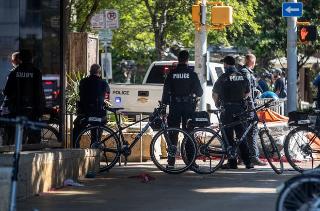 Austin police officers and other city employees clear out homeless encampments around City Hall on June 14. The Office of Police Oversight was created in 2018 to helpresidents register complaints against officers
