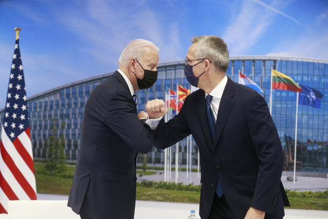 NATO Secretary General Jens Stoltenberg greets U.S. President Joe Biden with an elbow bump prior to a bilateral meeting on the sidelines of a NATO summit in Brussels, Monday. [STEPHANIE LECOCQ, POOL via AP]