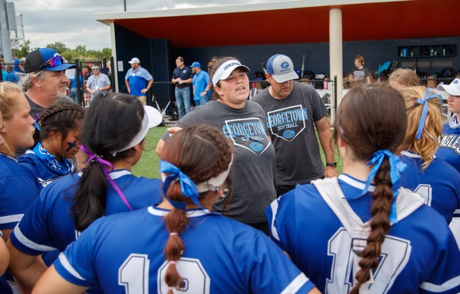 Georgetown softball coach Jessica Bond, speaking to her team after playing Aledo in the state tournament, has resigned. This year she led the Eagles to state for the first time in school history.