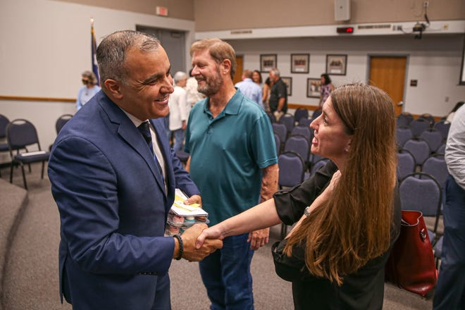 Hafedh Azaiez shakes hands with a parent Monday at the Round Rock school board meeting after being named the district's superintendent.