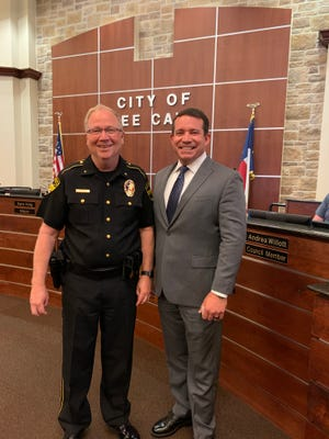 Austin Police Department Commander Brian Jones (right), who is the incoming Bee Cave police chief poses with outgoing Chief Gary Miller (left) at a recent Bee Cave City Council meeting.