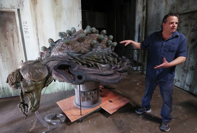 """David Barton talks about the newly acquired, Kaiju organ which rest an autopsy table, that is a prop from the film """"Pacific Rim"""" at Ghoul Brothers House of Horror Thursday June 10, 2021 in Akron."""