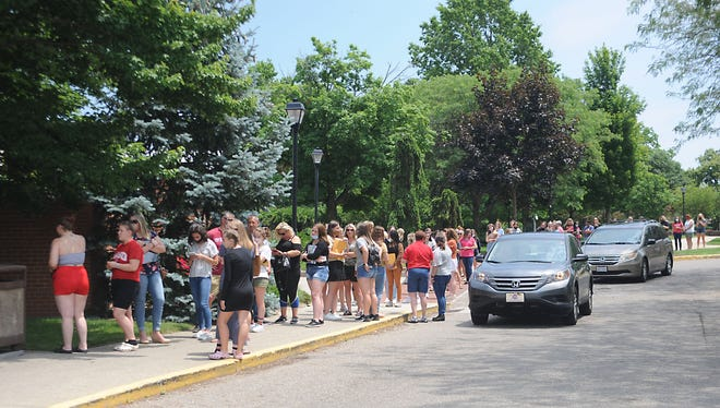 Participants wait in line for a temperature-check after arriving at University of Mount Union for the 2021 Buckeye Girls State.