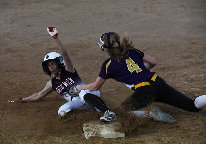 Roland-Story's Reagan Schmitz beats the tag by East Marshall's Morgan Neuroth at third base during the Norse's 10-2 victory over the Mustangs June 8 in Roland.