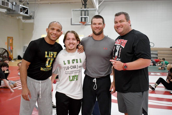 Life University and Screven County High School wrestling coaches collaborated for the June 8-9 camp at the recreation department that drew nearly 100 each day as the youth honed their abilities on the mats. Shown are Life University Head Coach Omi Acosta and Assistant Head Coach Cole Manion and SCHS Co-Head Coaches Griffen Greene and Andy Tomlin.