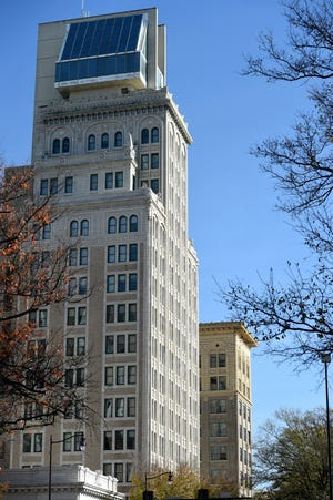 Downtown Augusta's Lamar Building (foreground) was purchased earlier this month by an Albany, Ga., developer who wants to build 70 market-rate apartments.