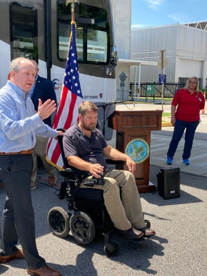Lucas Merrow, CEO of Moebius Mobility, and veteran Michael Bishop, outside the Charlie Norwood VA Medical Center in Augusta, where the company was donating two of its iBOT power wheelchairs.