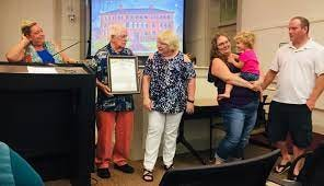 """Barnstable Town Councilor Jen Cullum recognizes the Kraus' volunteer efforts around their village and town in August 2019. """"Since I've been a town councilor, there's been no straighter arrow than Deb Krau. She says the tough things when the tough things need to be said. Ralph has been steady by our side,"""" Cullum said."""