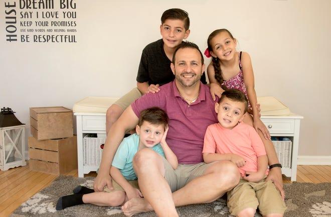 Fabio Sciarrino and his children (from left) Lorenzo, 4, Cristian, 11, Giuliana, 7, and Matteo, 4, in their Perkasie home on Saturday, June 12, 2021.