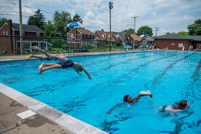 Residents enjoy the reopening of the Midland Pool Sunday, which was closed last summer due the COVID-19 pandemic.  [Lucy Schaly/For BCT]