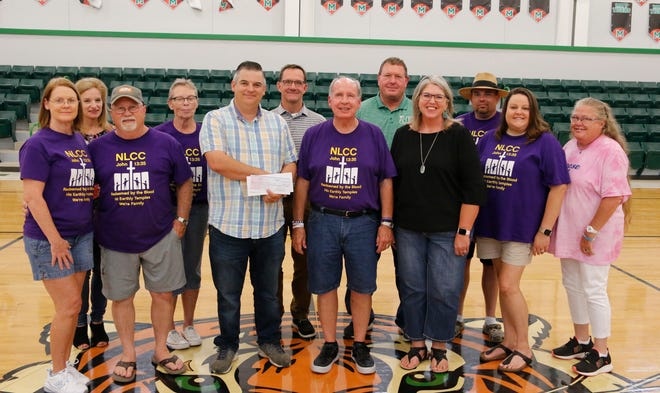 Representatives of North Lake Community Church and the May ISD are pictured recently in the May High School gym. From left are Marla Renfro, Janet Nash, Ray Renfro, Dee Hart, Frank Henderson, Nick Heupel, Ron Keener, Steve Howard, Allison Williams, Dusty Organ, Sheri Organ and Teresa Hobbs.
