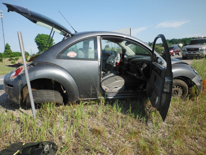 The Chebygan man who was driving this car was not injured after he lost control of the vehicle and rolled once on the side of northbound I-75. The vehicle landed back on its tires.