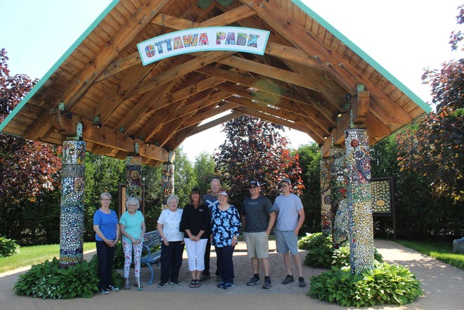 The Friends of Ottawa Park Board of Directors were very excited Jeff Friske and Thomas Friske (two on right) were able to install the new Ottawa Park sign Thursday morning. This was the first ever name sign for the park.