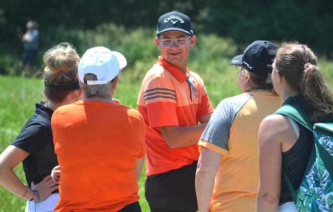 Cheboygan sophomore PJ Maybank III, middle, talks to family members during the second round of Saturday's Division 3 boys golf state finals held at The Meadows at Grand Valley State University.