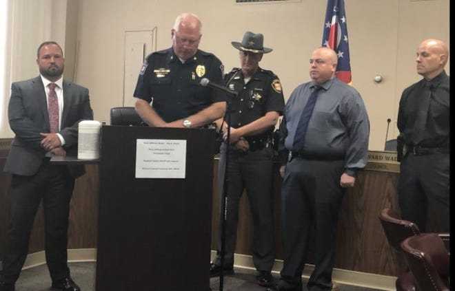 West Jefferson police Chief Chris Floyd, at podium, addresses the media on Monday, hours after 35-year-old John P. Steckel, of Columbus, was charged with four counts of murder in connection with a mass shooting May 24 at an apartment house on Jackson Street in the Madison County village.