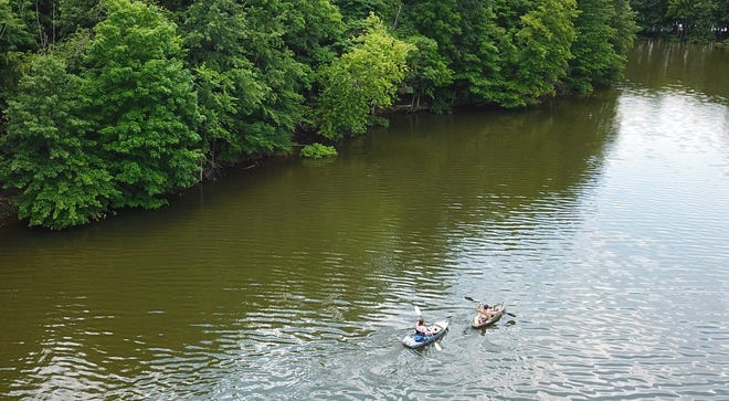 Kayakers Scott Weil of Whitehall and Brandon Michaels of Dublin paddle around Hoover Reservoir on Monday.