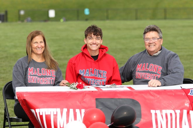 """Rittman's Logan St. Clair signed with Malone to run track earlier in the spring. He is pictured with his mother Wendy St. Clair (left) and father Rick St. Clair (right).   """"Signing with Malone is a huge blessing,"""" St. Clair said. """"Signing gives me a new opportunity to grow and compete, to the best of my ability, at the next level, while growing in my faith with an amazing college family."""""""