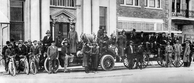 The Daytona Fire Department poses with new 1913 LaFrance firetruck in front of Merchants Bank on Beach Street.