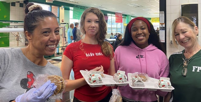 Two students (center) with two summer workers, Lisamarie Blum (L) and Laura Jean (LJ) Bencini (R).