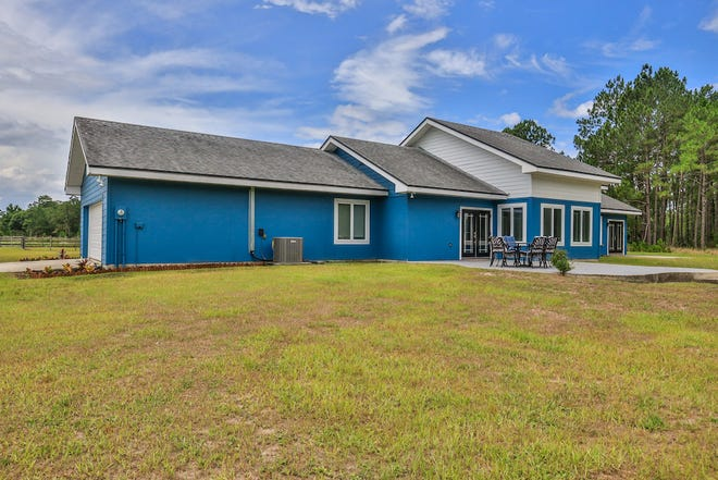 Built with the strongest materials and meticulously maintained, this amazing all-steel-frame ranch home sits on more than 10 acres of fenced land in New Smyrna Beach.