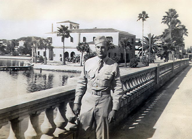 Photo of Herb Nerge on the Orange Avenue Bridge in the 1940s with the Daytona Beach Fire Station the background. Submitted by his daughter, Nancy Nerge Innes.