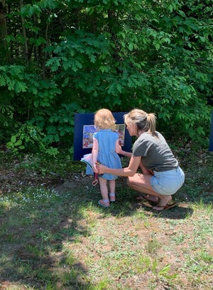 The Rochester Public Library Children's Room presented the first Story Walk® of the Summer this past weekend at the YMCA Healthy Kids event.