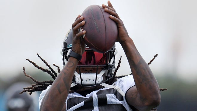 Jaguars cornerback Shaquill Griffin catches a ball during drills on the practice fields outside TIAA Bank Field during the Jacksonville Jaguars mandatory veterans minicamp session on Monday. [Bob Self/Florida Times-Union]