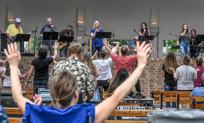 Members of the First Southern Baptist Church praise band perform a selection Saturday night in the Stevens Park bandshell during Praise in the Park.  The musical Beef Empire Days event featured praise groups from four local churches.