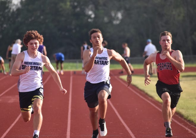 Ridgewood sprinters in the 100-meter dash on Friday, June 11, are Meric Veloz, left, and Alex Noyd, center, who were in the IHSA's Class 1A boys track sectional at Erie Middle School