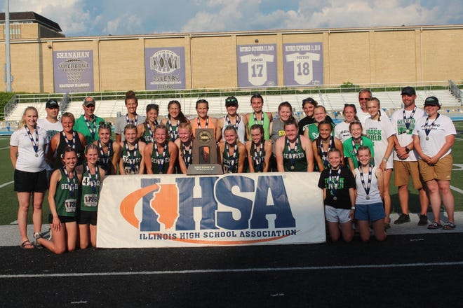 Geneseo Girls track team gathers around the second place overall trophy they  earned at State track finals in Charleston.