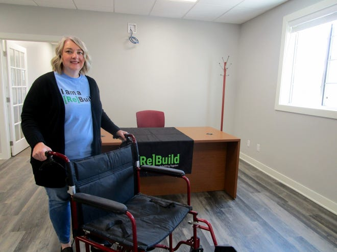 Sarah Snyder, executive director of Rebuildign Together Henry County, is shown in her office in the new home of Rebuilding Together Henry County.