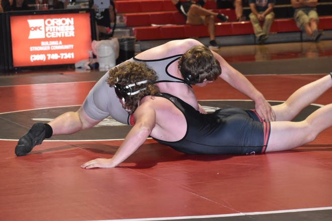 At 195 lbs., Orion's Phillip Dochterman, top, reaches to roll over Erie-Prophetstown's Jacob Otten in 5:30 on Saturday, June 5, in the Charger gym.