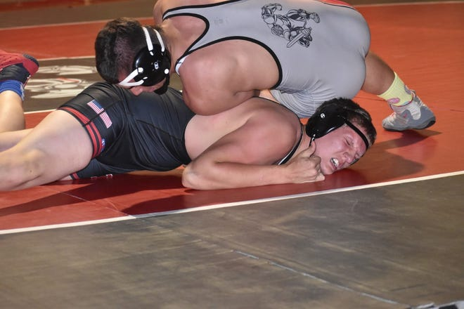 Wrestling at 220 lbs., Orion's Josh Fair, top, makes Erie-Prophetstown's Nick Ballard grimace before pinning him at 1:29 on Saturday morning, June 5, in the Charger gym.