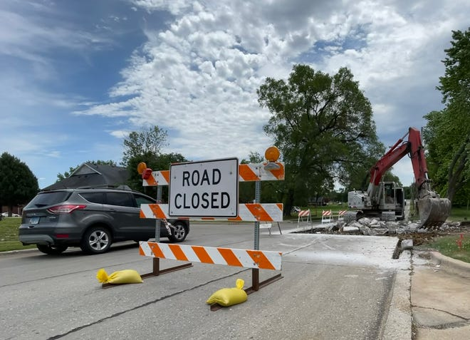 A crew from Brandt Construction works on Michigan Avenue just south of Hy-Vee on Monday. Michigan Avenue from Main Street to Grand Avenue is closed for approximately three weeks for pavement patching.