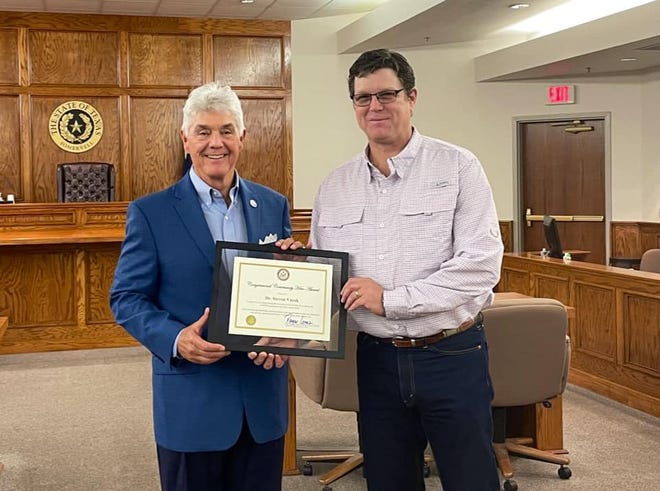 Rep. Roger Williams, R-Texas, left, presents Glen Rose physician Dr. Steven Vacek with the Congressional Hero Award. Vacek was an exceptional leader during the COVID-19 pandemic and was given the award on behalf of the Glen Rose community.