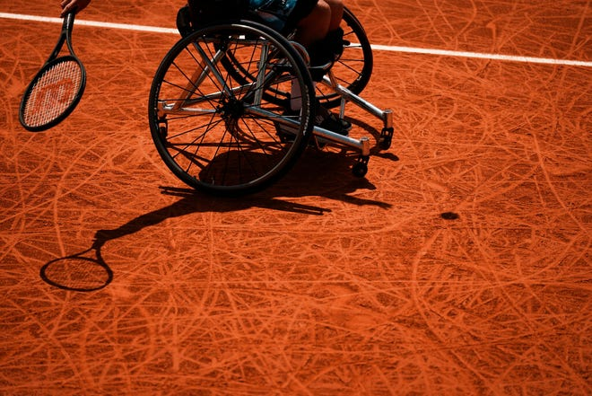 Japan's Shingo Kunieda plays a return to Alfie Hewett of Britain in the men's wheelchair final on day 9, of the French Open tennis tournament at Roland Garros in Paris, France, Monday, June 7, 2021. (AP Photo/Thibault Camus)