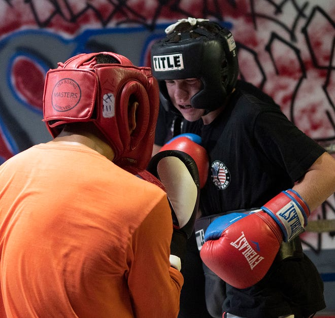 Eli Harkins, rights, sizes up his opponent in the first round of a recent sparring match at Rise, a boxing and martial arts gym on Locust Strreet in Hendersonville.