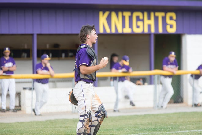 North Henderson catcher Colton Laughter holds the runners on base against Asheville earlier this season at North.