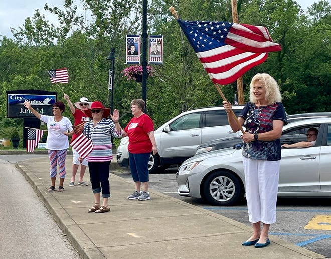 From left to right: Selma O'Dell-Humphreys, JoAnn Jones-Green, Marjie Parsons, Mary Pistelli and Carolyn Rader wave American flags outside of Ripley's City Hall.
