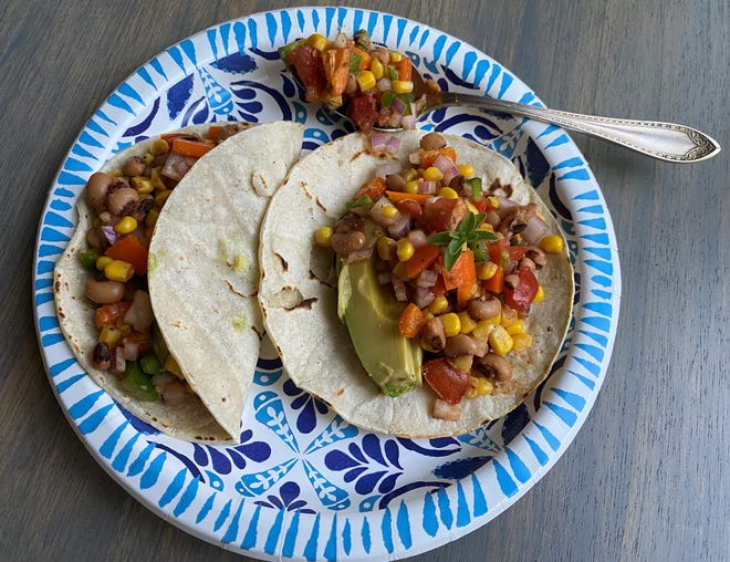 The seasonings in these Texas Caviar Tacos, mixed with fresh lime juice, result in a light sauce that is drizzled on, and stirring into the rest of the mixture.
