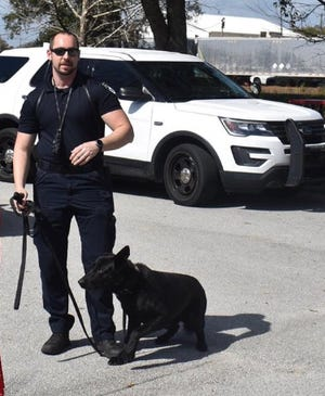 Officer Joseph Elam and his K-9 partner Cash in this undated photo from the Haines City Police Department.