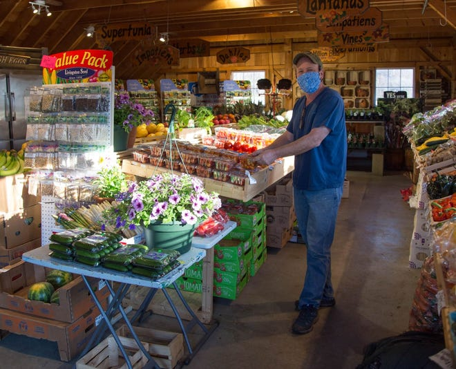 Neil Zanni, owner of The Gardeners' Spot, stands in the produce section that was one of the ways his store expanded during the COVID-19 pandemic.