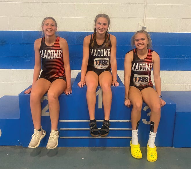Macomb's Laine Torrance, Madeline Benson and Khyliegh Diggs at the Class 2A state track and field meet.