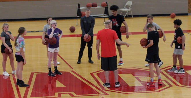 Moberly Area Community College men's basketball coach Patrick Smith on June 9 talks as he stands in the middle of eight young athletes that participated in the Greyhounds Skill Development Camp held June 7-10.
