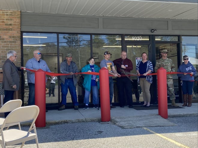 (From left to right) Local veterans Greg Withrow, Dan Stark, Glen Price, Connie Spice, William Bruck, Larry Mortimer, Jr., Crystal Bollinger, Tim Cousino and Jamie Paxton cut the ribbon at the grand opening last month at the Bedford Veterans Center.