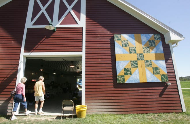 Customers walk into the Sussex County  Fairgrounds Farmer's Market, located at the county fairgrounds on Plains, in this file photo.