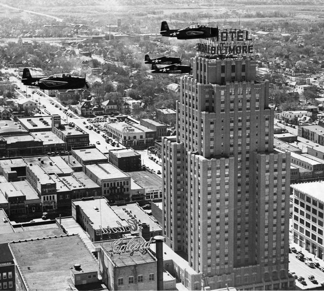 Fighter aircraft fly through downtown Oklahoma City on Nov. 23, 1945, drawing quite a bit of attention. The U.S. Navy airplanes that buzzed past the Biltmore Hotel and above the Colcord and other buildings were part of an effort to promote the Victory loan drive, a war bond campaign to help finance World War II.