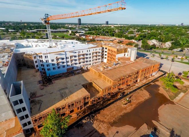 Crews continue construction on apartments at Classen Curve.