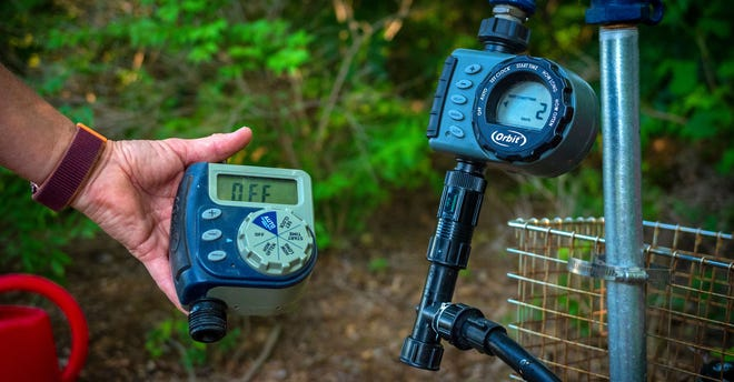 A simple irrigation system on a timer will help ensure the landscape survives while you're on vacation.