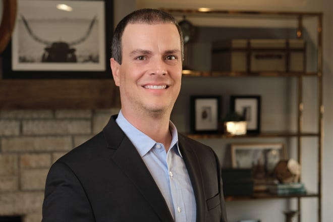 Lane Slovacek, promoted to vice president of sales for Ideal Homes & Neighborhoods..